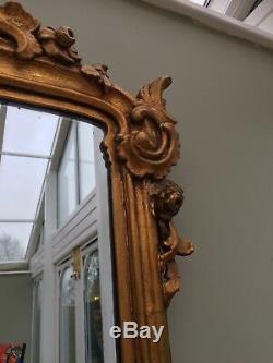 A Super Quality Mid 19th Century Gilded Rococo Carved Mirror. 54 Inches Tall