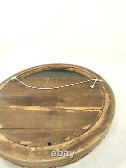 A Victorian 19th Century Carved Wood And Plaster Oval Gilt Mirror With Bow Top
