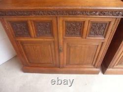 An Amazing Matching Pair of Carved Victorian Golden Oak Adjustable Bookshelves