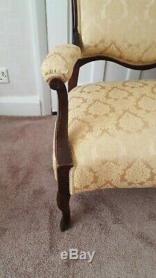 Ornate carved Victorian mahogany salon suite with new gold damask upholstery