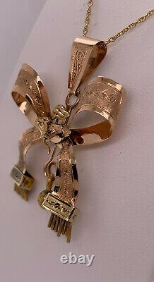 Victorian 14k rose & yellow gold etched Bow Pendant Carved Bird & Tassles 16.75