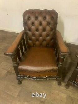 Victorian fire side chesterfield chairs a matching pair in browns and golds