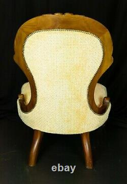 Victorian nursing chair, ornately carved mahogany frame, re-upholstered in gold