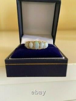 Victorian style 18 carat gold opal 5 stone ring, carved setting, size L/M